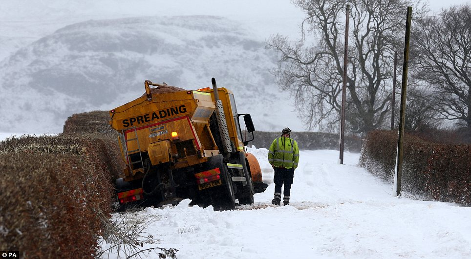 Embarrassing: A gritter slipped off the road near Kippen in Stirlingshire as the UK suffered from relentless snow