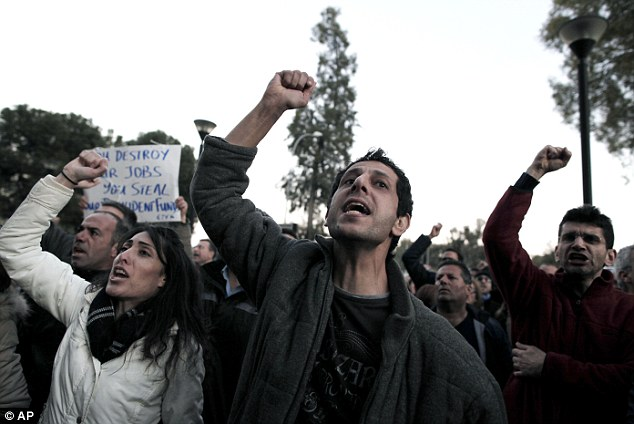 Chants: On Saturday, some 1,500 protesters, many of them bank workers, marched on the presidency, holding banners that read, 'No to the bankruptcy of Cyprus' and 'Hands of workers' welfare funds'
