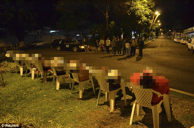 Onlookers: The bodies were found early yesterday morning near a roundabout in Uruapan, Michoacan state