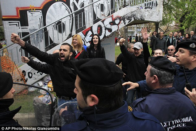 Anger: Golden Dawn supporters confronted other protestors demonstrating against the financial constraints imposed on Cyprus