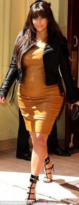 Strutting her stuff: Kim wore high gladiator inspired heels with her frock