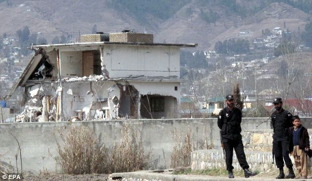 Pakistani police stand guard as workers demolish Bin Laden's compound: With the scene of the raid torn down there is now no way to forensically investigate which of the various accounts is actually true