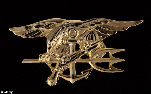 The U.S. Navy SEAL insignia: Members of the secretive unit are supposedly bound by oaths of silence