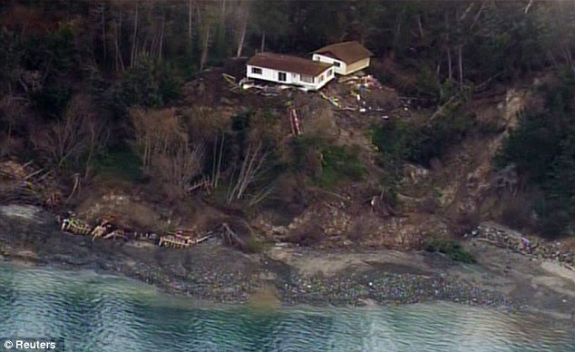 Destruction: One home was knocked off its foundation and swept hundreds of yards down the hillside