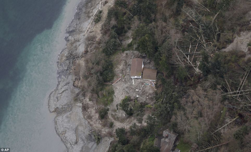 Displaced: This home was most dramatically displaced after it was knocked off its foundations when the landslide began at 4 a.m. on Wednesday