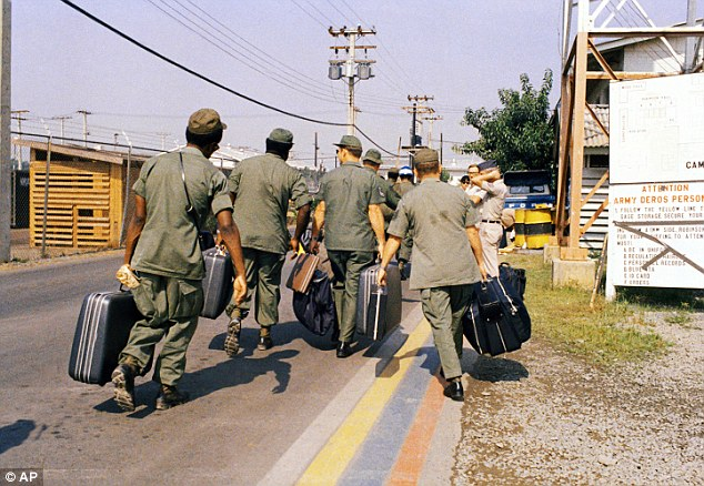 Exit: In this March 29, 1973 photo, Camp Alpha, Uncle Sam's out processing center, was chaos in Saigon