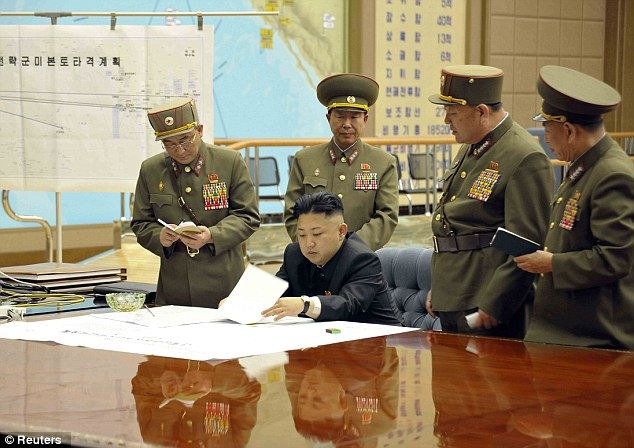 War bunker: North Korean leader Kim Jong-un presides over an urgent operation meeting with his generals after the country put its rocket units on standby to attack U.S. military bases in South Korea and the Pacific