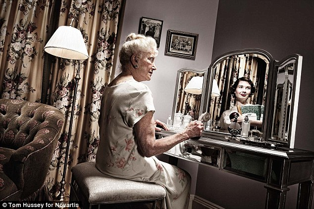 How we were: An elderly woman clutches a comb for her white hair while the dark-haired reflection of a young school teacher, a notebook and red apple in her arms, reflects back in her mirror