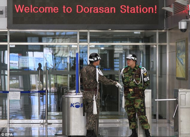 On guard: South Korean soldiers at the nearest railway station to the border