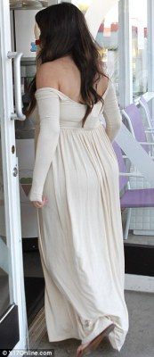 Looking just swell: The star's blossoming baby bump was clearly visible underneath her dress