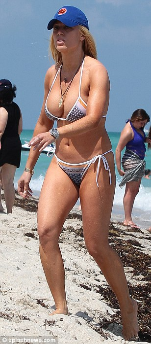 Fit: Jill showed off her toned limbs as she strutted on the beach