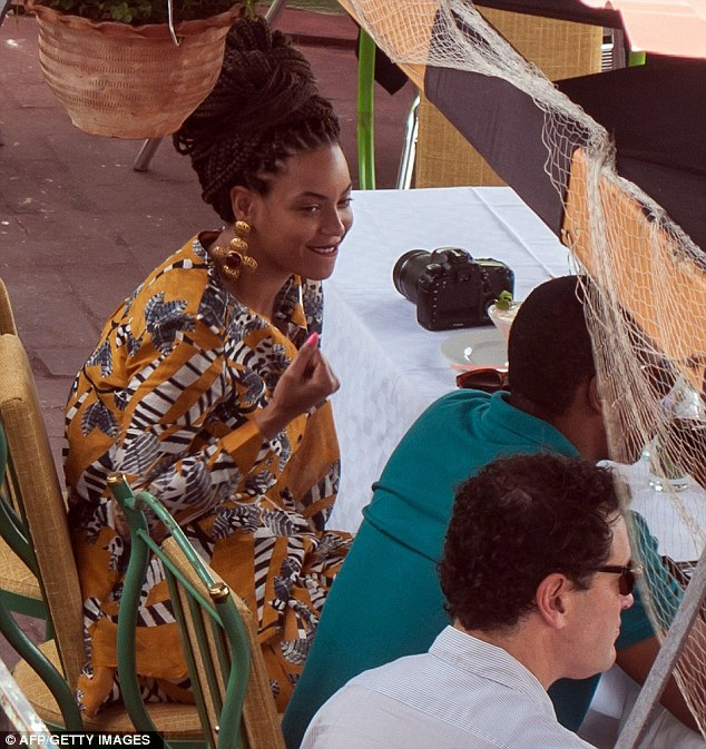 Taking a breather: Beyonce and Jay-Z took stopped for lunch at a restaurant which boasted a rooftop terrace with a sweeping view of the harbour