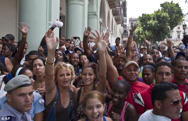 Fan frenzy: Crowds assembled outside the Saratoga hotel in a bid to catch a glimpse of the singer in Old Havana
