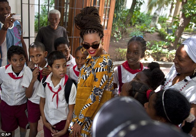 Famous visitor: Beyonce took time out to chat to the local children