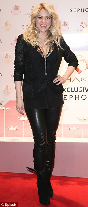 Yummy mummy: Shakira looking trim at her fragrance launch in Paris on March 27