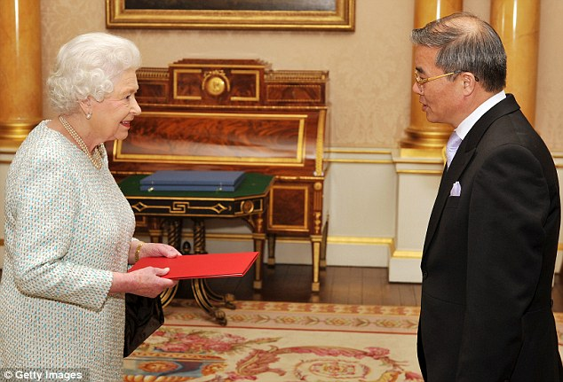 Honour: Hyon Hak Bong, the North Korean ambassador, presents his credentials to the Queen in a private audience at Buckingham Palace last year
