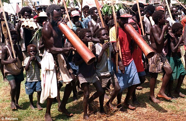 Villagers: Residents of the island of Bougainville have executed two women for witchcraft (other locals are pictured in this file photo)