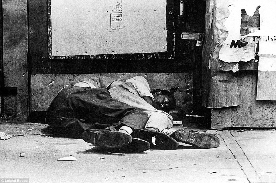 Two men are seen sleeping together on the street in the Bowery