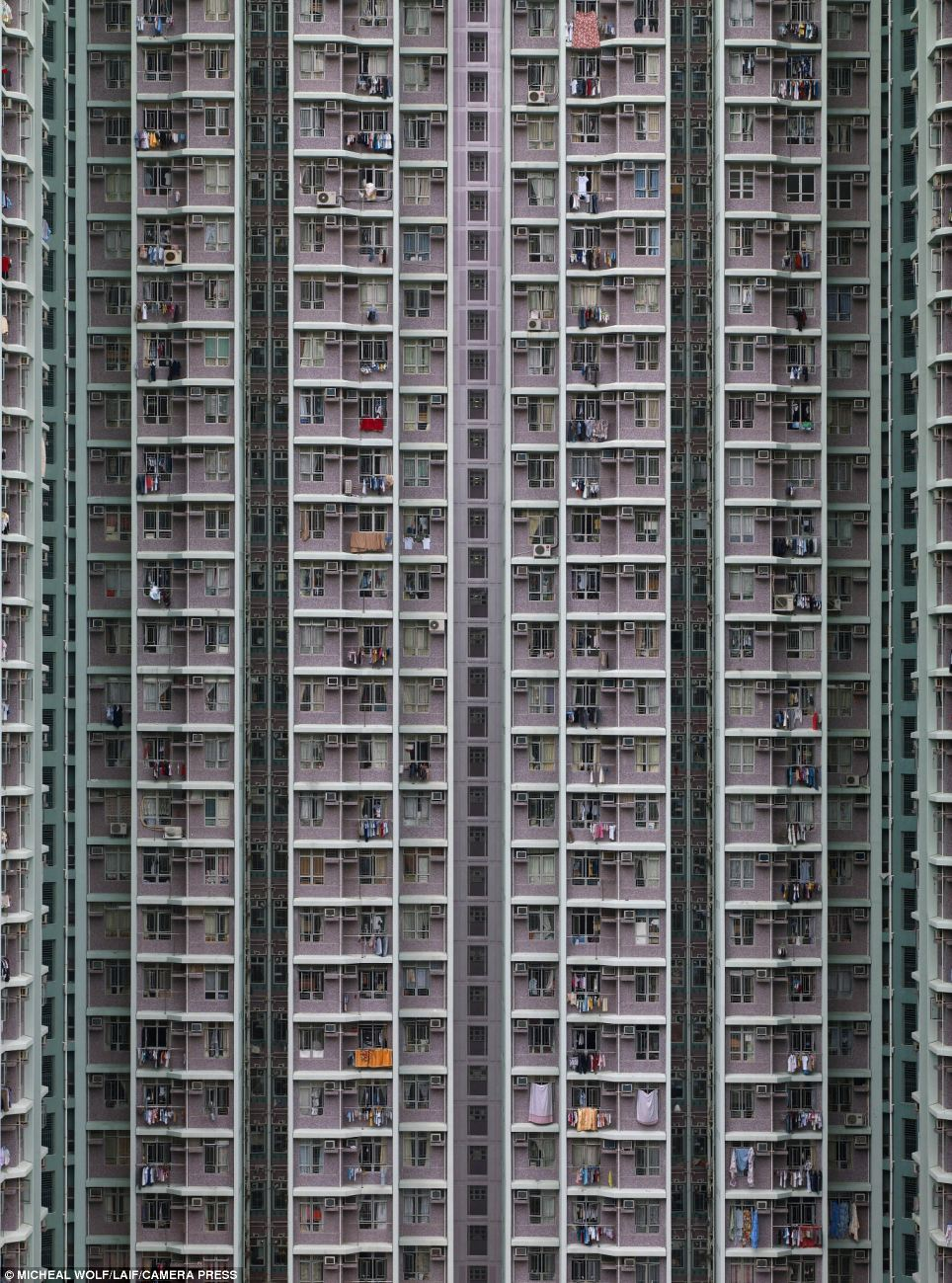 Neighbours: Despite being one of the world's richest cities, the high cost of renting in Hong Kong means many of its residents are forced to set up home in incredibly cramped living spaces