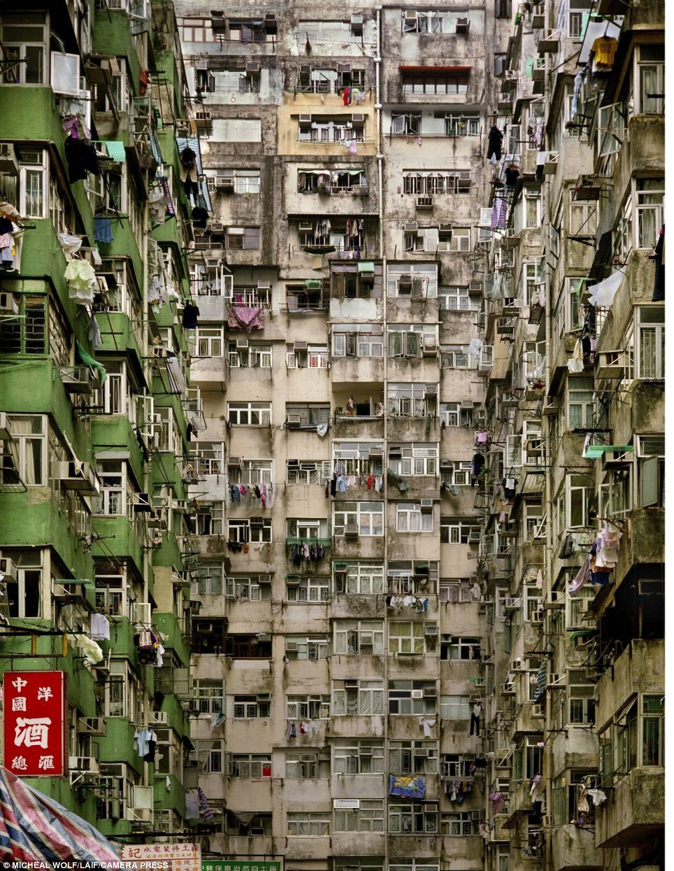 Dilapidated: The photographer documents some less than idyllic living quarters in Hong Kong, where charities have highlighted the plight of underprivileged residents trying to afford a home in a place where space is at a premium