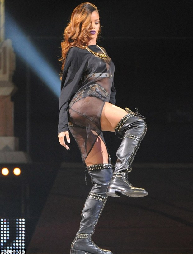 Pop royalty: The Stay singer took to the stage in thigh-high leather boots and gold and black briefs
