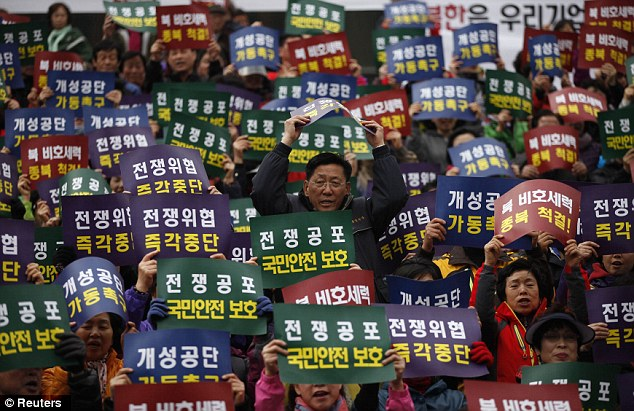Unrest: Members of the Korea Freedom Federation chant slogans during a rally for North Korea to re-start operations at the joint Kaesong Industrial Complex as the country remained on high alert