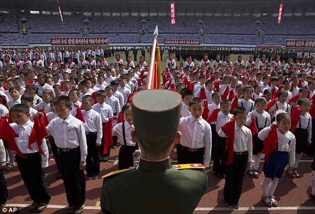 Rogue regime: Thousands gathered at the Kim Il Sung Stadium in the North Korean capital of Pyongyang to watch the youngsters be sworn in