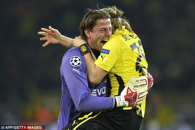 Overjoyed: Borussia Dortmund keeper Roman Weidenfeller (left) celebrates after a dramatic win over Malaga