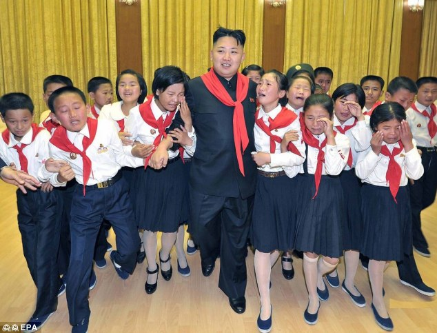 Admired and adored: The rule of Kim Jong Un has been compared to Nazi Germany, with photographs like this drawing parallels to Hitler Jugend meetings