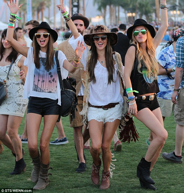 Angels have landed: Victoria's Secret models Miranda Kerr (left) and Alessandra Ambrosio were in the party spirit as they descended on the festival