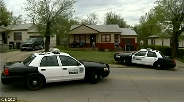 Ambush: Officers swarmed two homes, one pictured, just hours after a morning bank robbery at Oklahoma City's MidFirst Bank