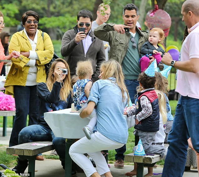 Guest of honour: The attendees took snaps of the youngster celebrating a new age