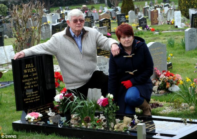 Ron Wilkes, 78, with his daughter Debbie Reynolds whose daughter Hayley shares the grave which was vandalised with her grandmother Jill