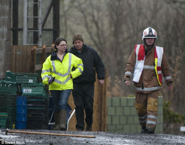Fire incident commander Fraser Simpson, right, with a SEPA Investigator and the Zoo owner Brian Curran at the scene of the fire