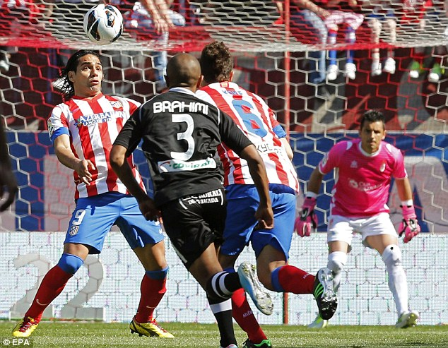 Wanted: Radamel Falcao (left) in action during Atletico Madrid's victory over Granada