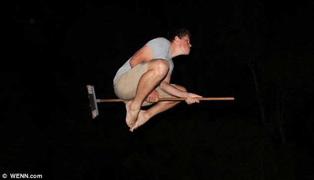 In the dark: This young man has the right idea but the wrong broom
