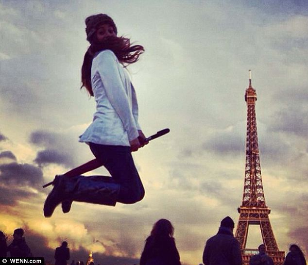 She's a real Eiffel: The trend has become so popular that it has reached as far as Paris in France