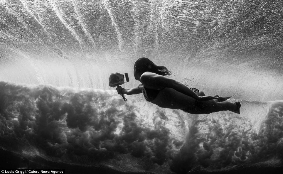 Pushed to her limits: Lucia Griggi, pictured underwater, pushed herself to the limits of endurance as she dived deep underwater to capture the amazing views of competitors