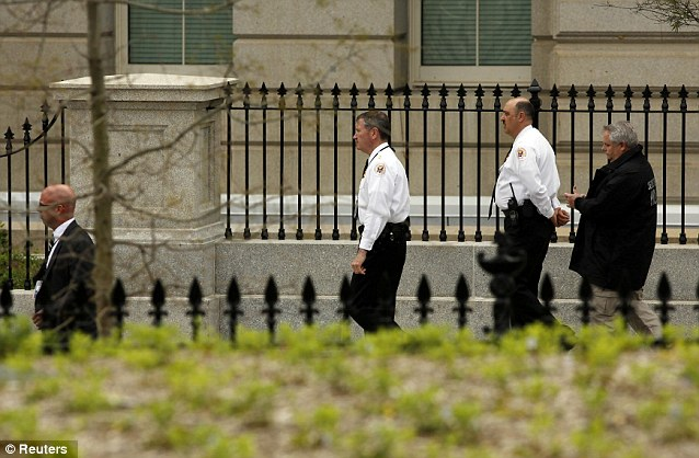 U.S. Secret Service agents walk around the White House complex after two explosions struck the Boston Marathon