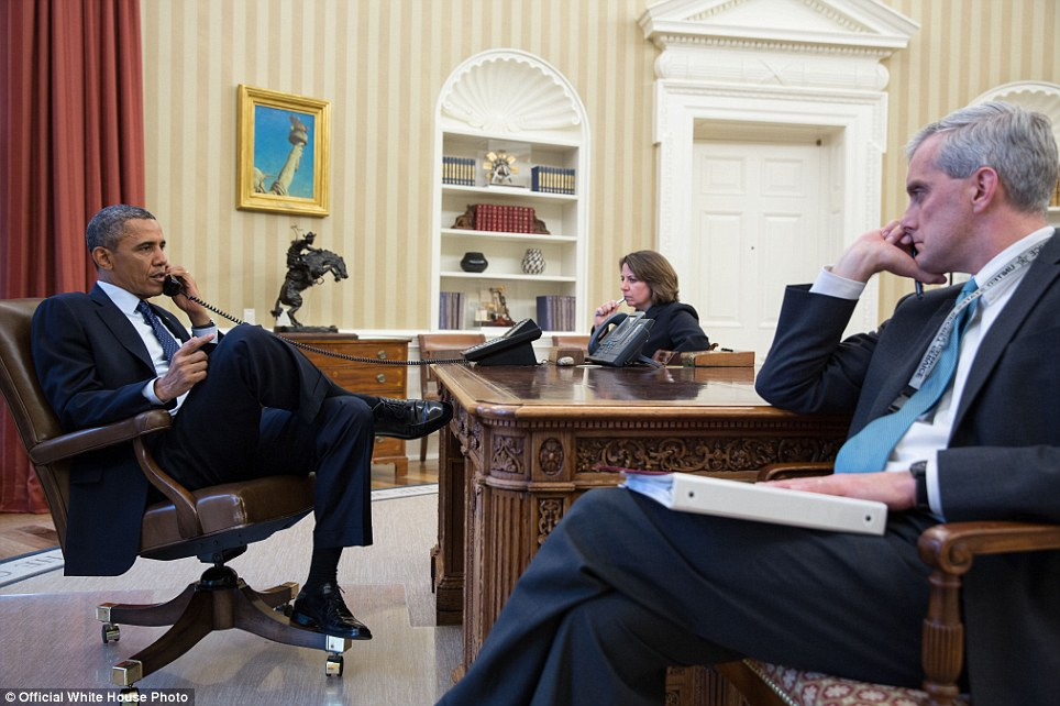 President Obama talks on the phone in the Oval Office today with FBI Director Robert Mueller and was seated with Lisa Monaco, head of Homeland Security, and Chief of Staff Denis McDonough and was briefed on the attack