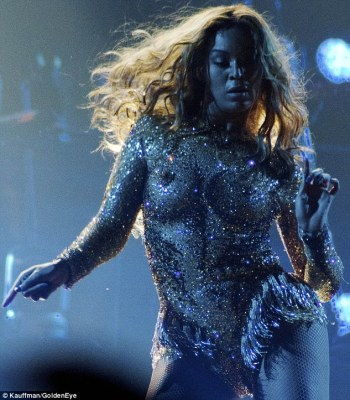 Dancing queen: The fringe-lined bodysuit accentuated the singer's every move