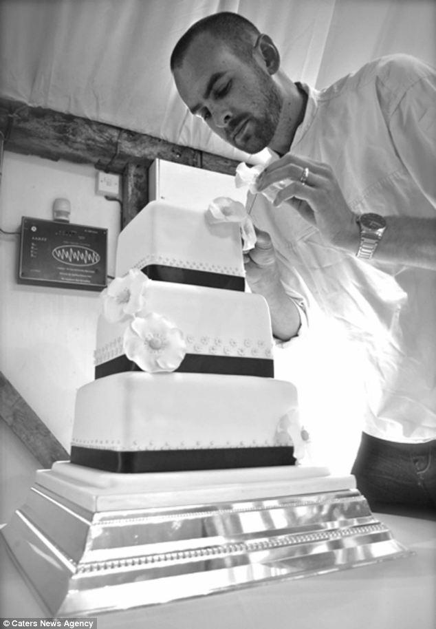 Chris Holmes icing cake