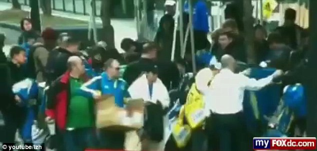Stealing? Video footage from the aftermath of the Boston Marathon bombings appears to show dozens of people stealing merchandise that was meant for runners who finished the race