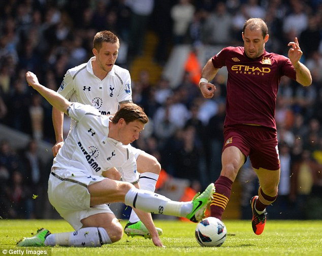 Sticking the boot in: Jan Vertonghen stretched out a leg to pinch the ball of Manchester City's Pablo Zabaleta