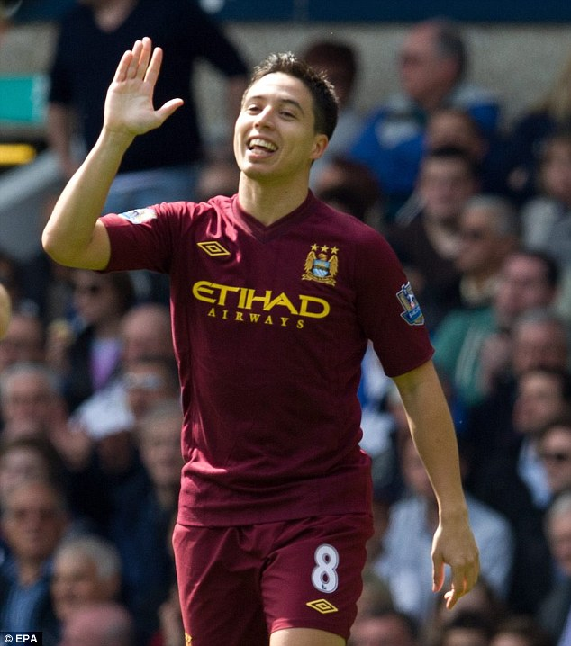 All smiles: Nasri broke the deadlock after just five minutes at White Hart Lane