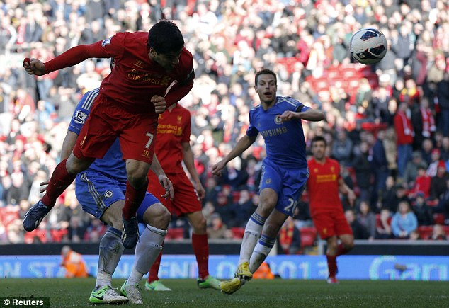 Last laugh: Suarez denied Chelsea a win right at the death when he headed in Sturridge's cross