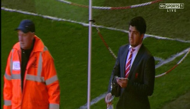 Concern: Suarez didn't look particularly happy on his departure