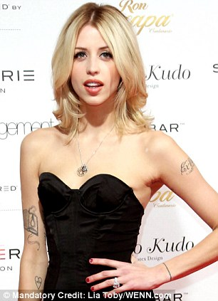 Sinister: Peaches Geldof has an 'OTO' tattoo (left) which is an acronym for the creepy Ordo Templi Orientis