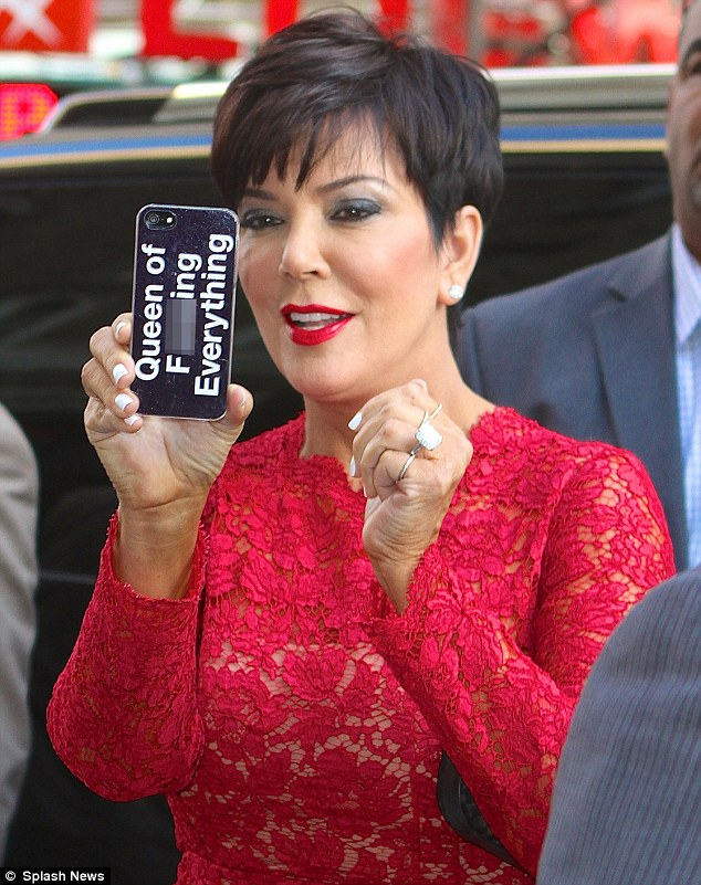 Statement case: Kris Jenner displayed a crude message on the back of her mobile phone on Monday as she stepped out in New York City