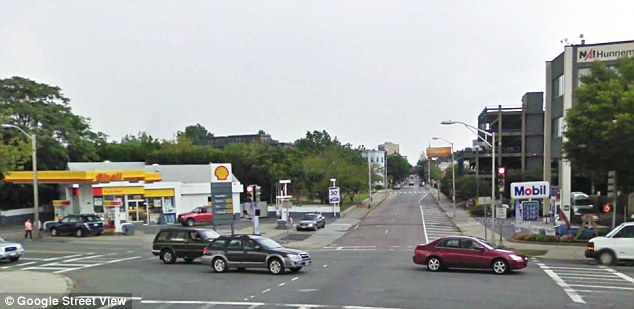 Escape: The two bombing suspects pulled up at the Shell gas station to use a stolen ATM card from a man they had taken hostage. He managed to escape to the Mobil gas station across the street and call for help (right)